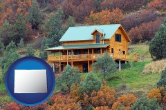 colorado map icon and a mountainside vacation home