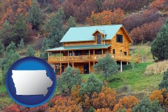 iowa map icon and a mountainside vacation home