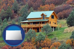 north-dakota map icon and a mountainside vacation home