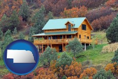 nebraska map icon and a mountainside vacation home